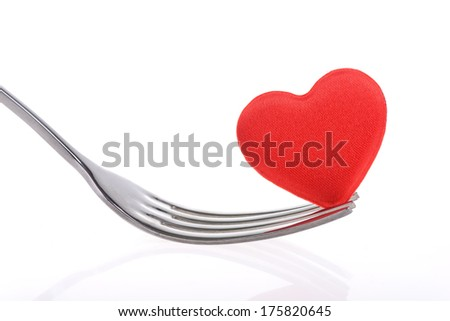 Red heart with fork on white background - stock photo