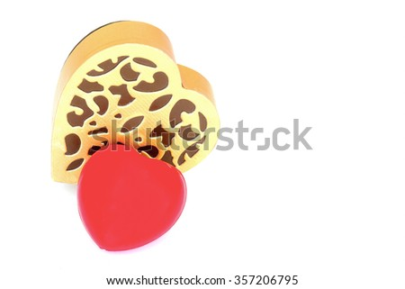 Red heart with golden heart box on white background - stock photo