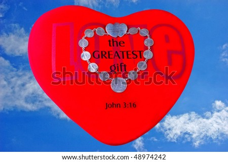 Red heart with marriage token coins against a blue sky - stock photo