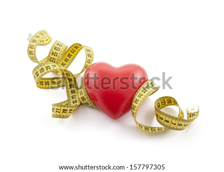 Red heart with yellow tape measure. Clipping path included. - stock photo