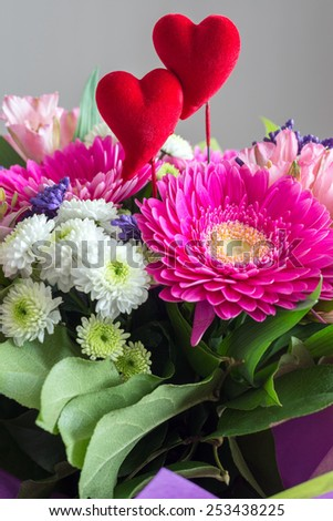 Red hearts and a bouquet of a flowers - stock photo