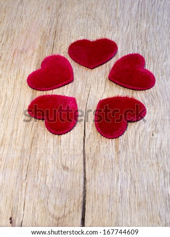 red hearts are on  oak planks