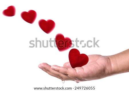 Red hearts fly into hand on white background . Love concept - stock photo