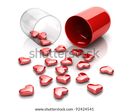 Red hearts from drug capsule - stock photo