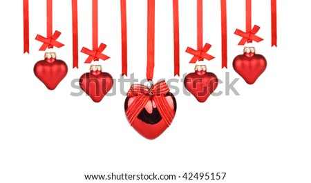 Red hearts hanging on ribbons with place for your text on a white background. - stock photo