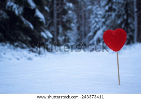 Red hearts in glittering snow day valentines - stock photo
