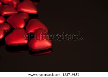 Red Hearts on Black Glass - stock photo