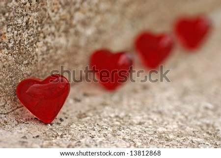 red hearts on stone - stock photo