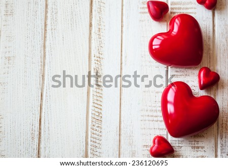 Red hearts on the vintage wooden background - stock photo
