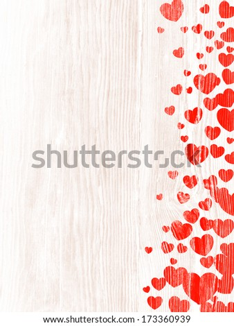 Red hearts on the wood texture.
