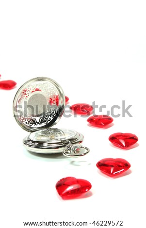 Red hearts on white background with a pocket watch