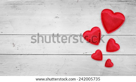 Red hearts on wood  - stock photo