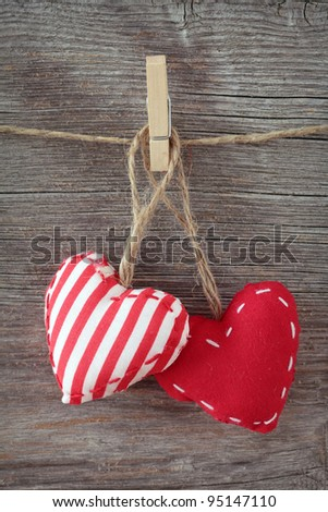 Red hearts on wooden background - stock photo