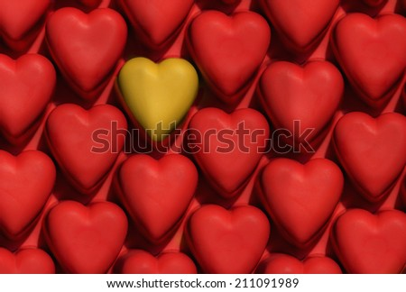 red hearts pattern with one yellow isolated heart - stock photo