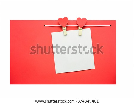 Red hearts with clothespins hanging on clothesline isolated on black background.  Signboard frame on  wood background. Valentines Day  - stock photo