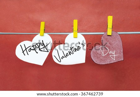 Red hearts with clothespins hanging on clothesline on color background. date, love Happy Valentines Day concept - stock photo
