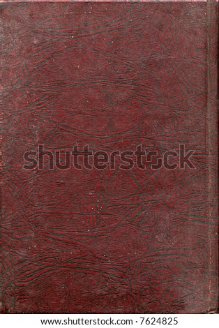 Red, heavily lined faux-leather from a book-cover spotted with white, suitable for use as a background texture. - stock photo