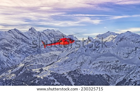 Red helicopter at swiss alps near Jungfrau mountain Bern canton highland Interlaken area