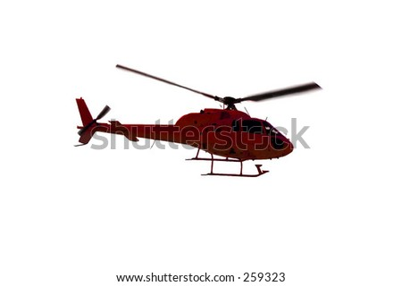 Red helicopter in the air over a PURE WHITE background. - stock photo