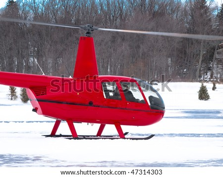 Red helicopter in winter - stock photo