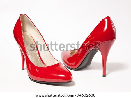 Red high heel women shoes on white background - stock photo