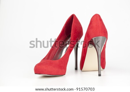 Red high heels isolated on white background - stock photo