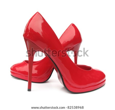 Red high heels pump shoes - stock photo