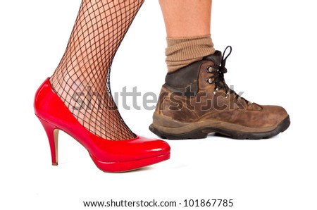 Red high hill shoe and brown walking boots on a white background - stock photo