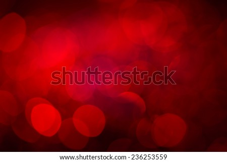 Red holiday party background. Abstract with bright twinkles, sparkles, blurred, defocused light. - stock photo