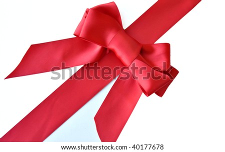 red holiday ribbon and bow for gift wrapping