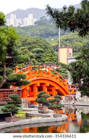 Red Hong Kong bridge,Chinese style architecture in Nan Lian Garden, Hong Kong - stock photo