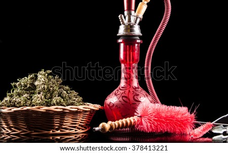Red hookah on a black background - stock photo