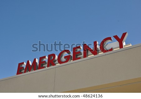 Red Hospital Emergency Sign with Blue Sky