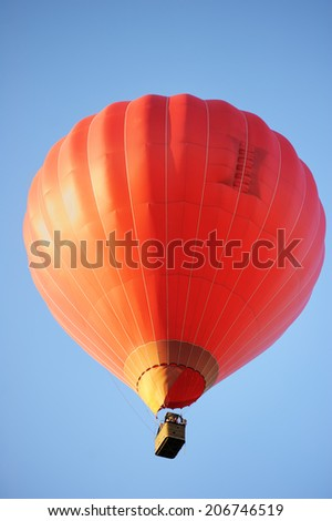 Red hot air balloon on blue background - stock photo