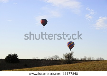 Red hot air balloon over farm fields near Omaha Nebraska - stock photo
