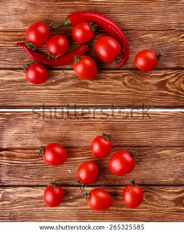 Red hot cherry and chili peppers over white wooden background - stock photo