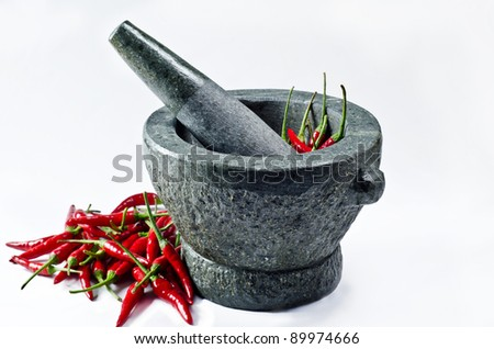 Red hot chili in motar - stock photo