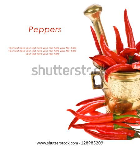 red hot chili pepper in a copper mortar isolated on a white background - stock photo