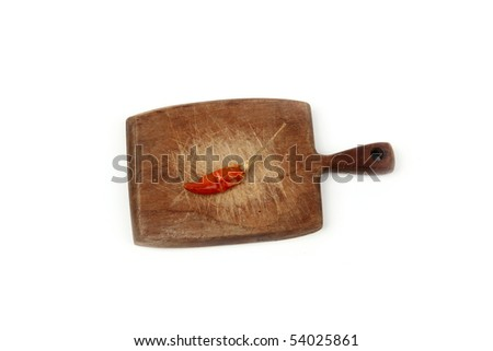 Red hot chili pepper on the wooden board - stock photo