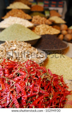 red hot chili peppers and other spices on indian market - stock photo