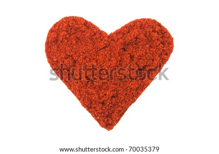 Red hot chili peppers in a heart shape. Over a white background - stock photo