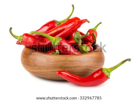 Red hot chili peppers in wooden bowl on white background - stock photo