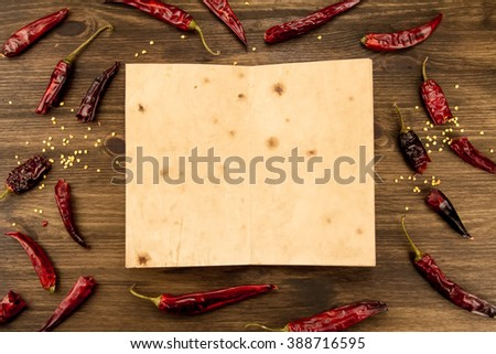 Red hot chili peppers on old wooden table.  Recipe, menu, mock up, cooking. - stock photo