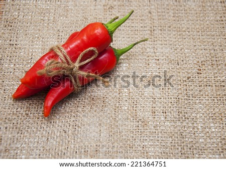 Red Hot Chili Peppers over burlap background