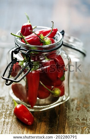 Red Hot Chili Peppers over wooden background - stock photo