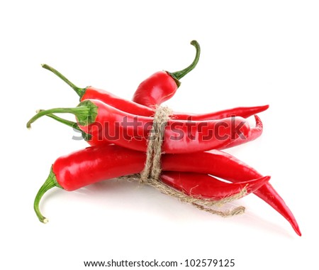 Red hot chili peppers tied with rope isolated on white - stock photo