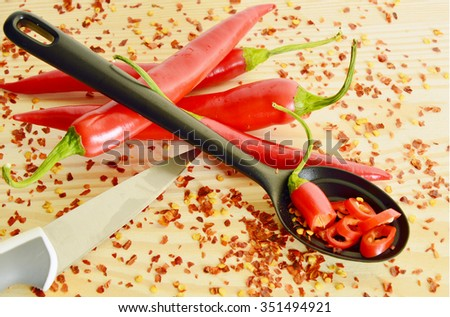 red hot chili peppers with cayenne in Heart-shaped cup - stock photo