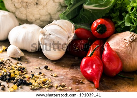 Red Hot chili peppers with garlic and mixed spices on the wooden background