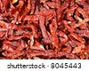 red hot chillies at display in market - stock photo