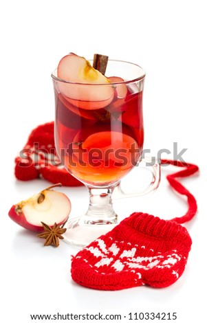 Red hot drink with apple slices - stock photo